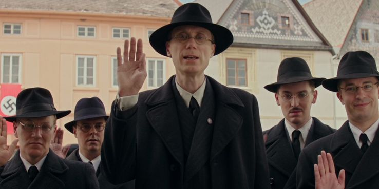 Stephen Merchant (Captain Deertz) arrive at the Betzler home for a surprise search.