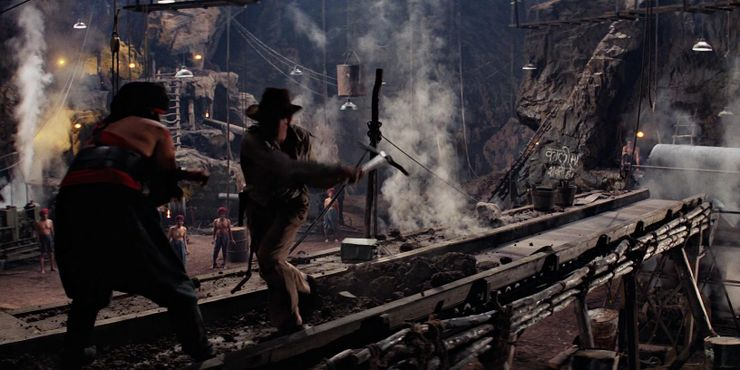 During the climactic set-piece in Temple of Doom, Indy kills a hulking slave overseer with a rock crusher.